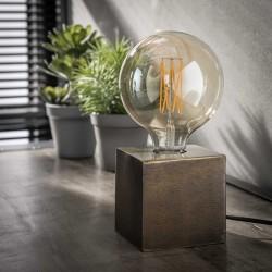 Lampe de table une ampoule posée sur un cube plein finitions bronze antique de style minimaliste et moderne